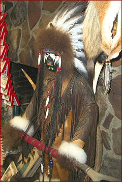 You will find beautiful examples of American Indian art at Golden Eagle, like this large warrior figure, embellished with hides, fringe, beads, a feather headdress and war paint.