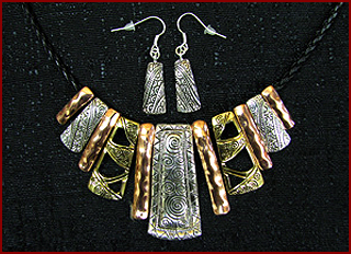 Taos Mountain Candles and gifts carries a line of beautiful jewelry, including this tri color necklace and earring set.